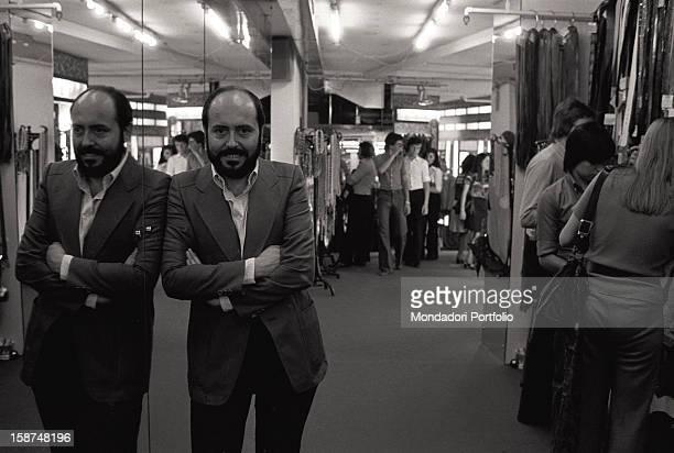 Italian fashion designer and entrepreneur Elio Fiorucci posing in a department of his shop in San Babila square Milan 1974