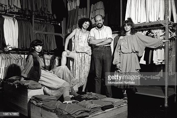 Italian fashion designer and entrepreneur Elio Fiorucci posing with the shop assistants of the shop where the retailers stock up Milan 1974