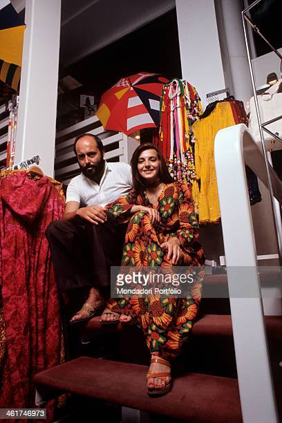 Italian fashion designer and entrepreneur Elio Fiorucci posing with the shop assistant Cristina Bagnoli in his shop in Galleria Passarella Milan 1970