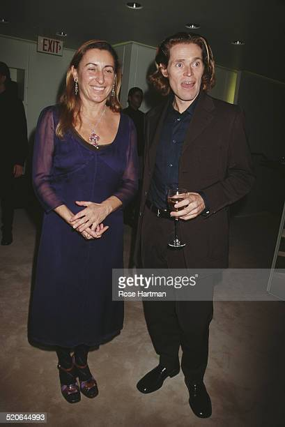 Italian fashion designer and entrepreneur Miuccia Prada with American film and stage actor Willem Dafoe at the Prada boutique opening party New York...