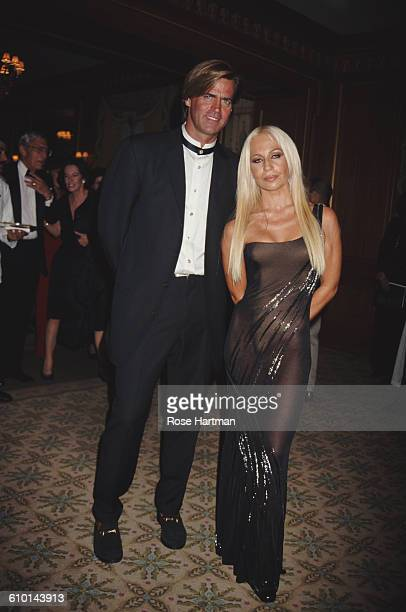 Italian fashion designer Donatella Versace and husband Paul Beck attend the 13th Annual Night of Stars at the Pierre Hotel New York New York 1996