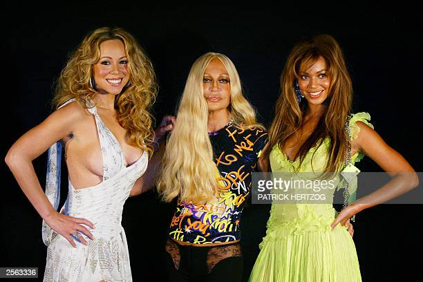 Italian fashion designer Donatella Versace poses with US singers Mariah Carey and Beyonce of group Destiny's Child before Versace's show and...