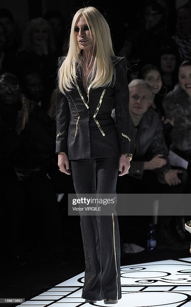 Italian fashion designer Donatella Versace walkS the runway during the Atelier Versace Spring/Summer 2013 Haute-Couture show as part of Paris Fashion Week at Le Centorial on January 20, 2013 in Paris, France.