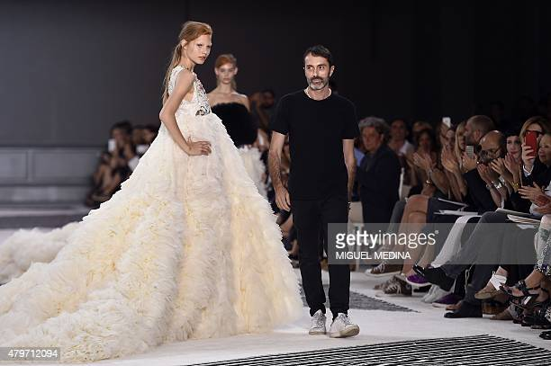 Italian fashion designer Giambattista Valli acknowledges the public at the end of h is 20152016 fall/winter Haute Couture collection fashion show on...