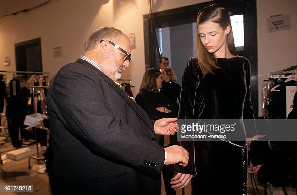 Italian fashion designer Gianfranco Ferré in the last preparations of his parade for the spring/summer collection at the Palace of Art checks the...