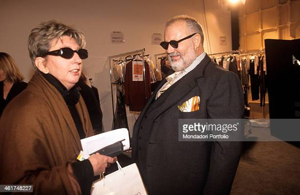 Italian fashion designer Gianfranco Ferré in the preparations of his parade for the spring/summer collection at the Palace of Art talks with a...