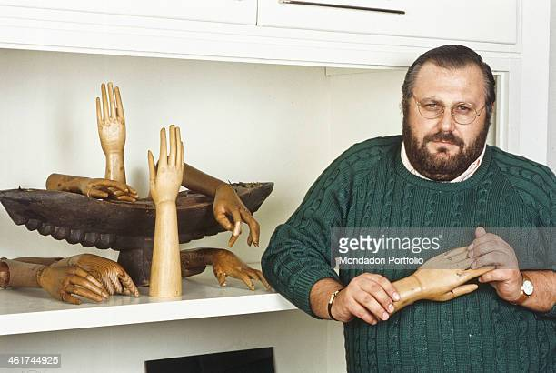 Italian fashion designer Gianfranco Ferré posing beside some mannequin hands Italy 1984