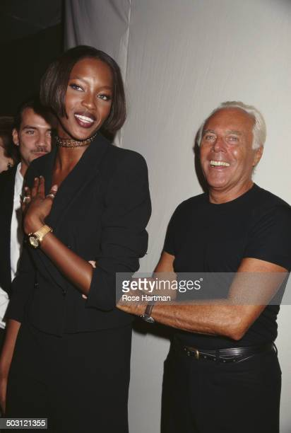 Italian fashion designer Giorgio Armani and English model Naomi Campbell attend a private party 1996