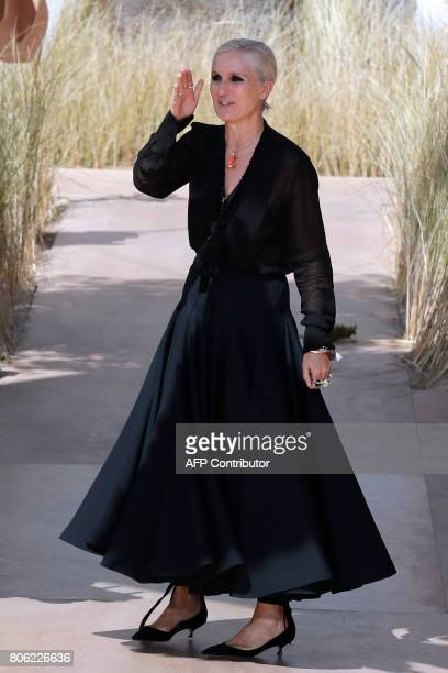 Italian fashion designer Maria Grazia Chiuri for Christian Dior acknowledges the audience at the end of the 2017 fall/winter Haute Couture collection...
