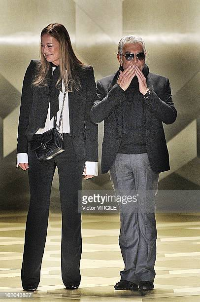 Italian fashion designer Roberto Cavalli and his wife Eva walk the runway at the Roberto Cavalli Ready to Wear Fall/Winter 20132014 fashion show as...