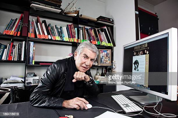 Italian fashion designer Roberto Cavalli updating his blog seated in front of a computer at his office Sesto Fiorentino 5th April 2012
