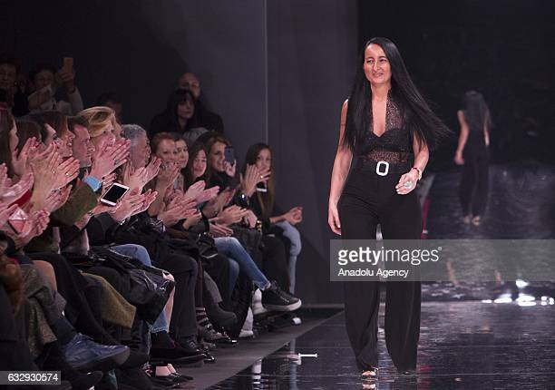 Italian fashion designer Sabrina Persechino walks on the catwalk after presenting her SpringSummer 2017 collection during the AltaRoma fashion show...