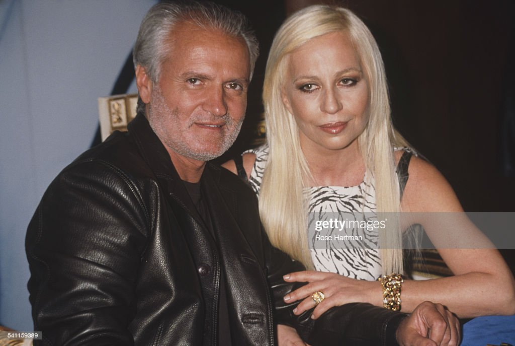 Italian fashion designers Gianni (1946 - 1997) and Donatella Versace at the launch for their new fragrance 'Versace's Blonde', USA, circa 1996.