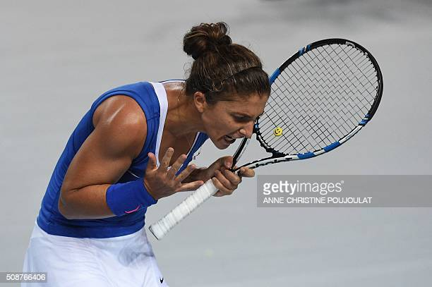 TOPSHOT Italian Fed Cup player Sara Errani reacts after losing a point against France's Fed Cup player Caroline Garcia during the first round of thr...