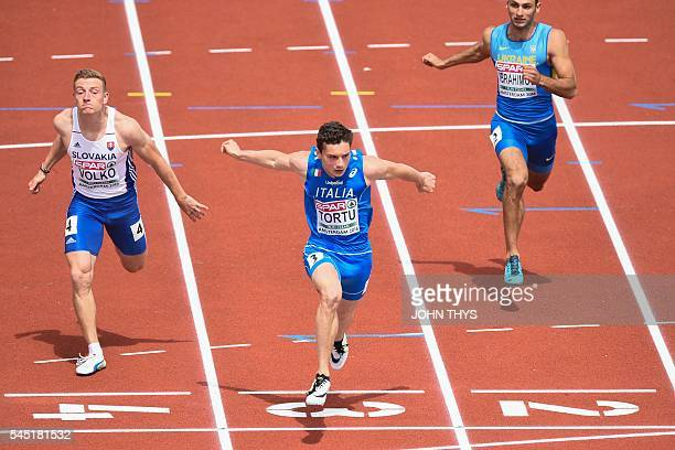 Italian Filippo Tortu crosses the finish and wins the Men's 100m qualification round during the European Athletics Championships at the Olympic...