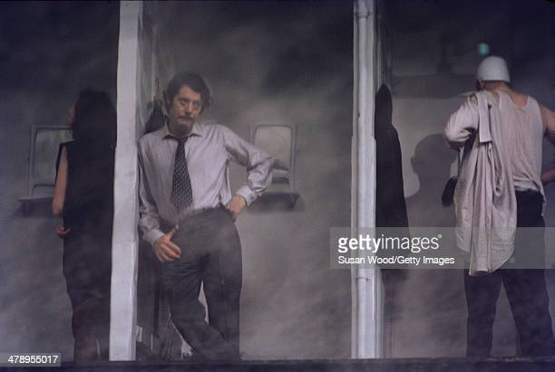 Italian film actor Marcello Mastroianni leans on the wall of a changing stall in a scene from the film 'Leo the Last' England 1970
