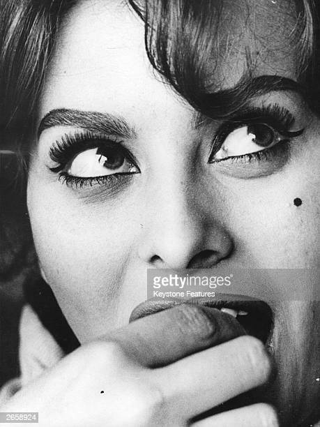 Italian film actress Sophia Loren on the phone to her mother