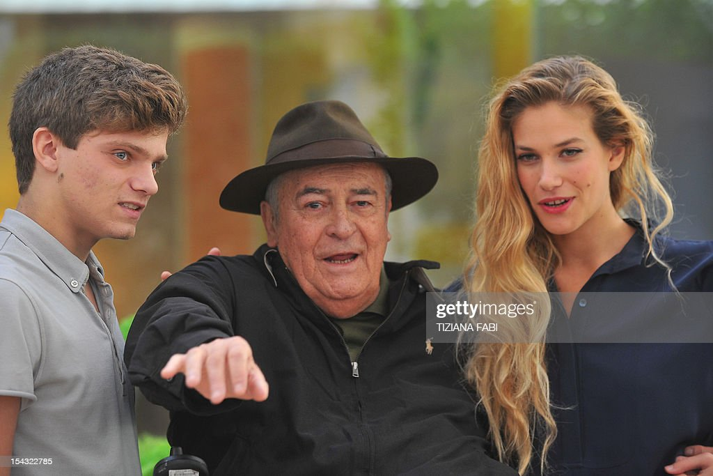 Italian film director Bernardo Bertolucci (C) is flanked by Italian actor Jacopo Olmi Antinori (L) and Tea Falco during the photocall for 'Io e Te' (Me and You) on October 18, 2012 in Rome. 'Io and Te' was presented during the 2012 Cannes film festival.
