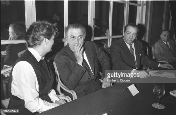 Italian film director Federico Fellini at the 'Grand Hotel' with film director Luchino Visconti and screenwriter and actress Suso Cecchi d'Amico Rome...