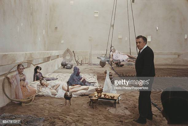 Italian film director Federico Fellini directs various actresses in roman costume on the set of the film 'Fellini Satyricon' in Rome Italy in 1969