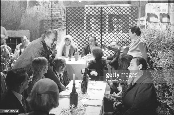 Italian film director Federico Fellini having dinner with Alberto Sordi and other friends during the shooting of the movie 'Roma' Rome 1971