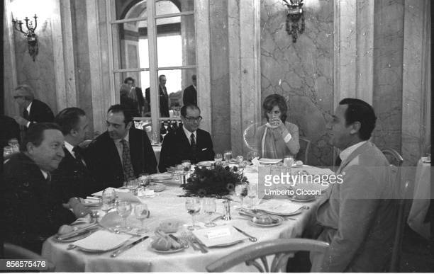 Italian film director Federico Fellini having lunch at the 'Grand Hotel Palace' with Alberto Sordi Claudia Cardinale Luchino Visconti Franco Malfatti...