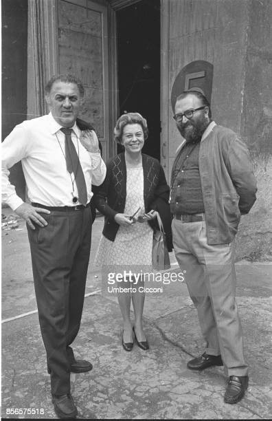 Italian film director Federico Fellini is with his wife and actress Giulietta Masina and Italian film director Sergio Leone at Cinecittà studios Rome...