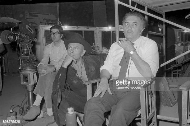 Italian film director Federico Fellini is with Russianborn film and stage actor Yul Brynner during a shooting in Cinecittà studios