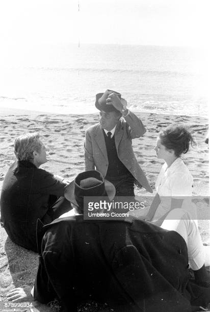 Italian film director Federico Fellini talks to actors at the seaplane base in 'Ostia Lido' during the shooting of movie 8 ½