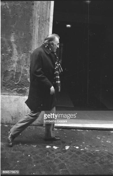 Italian film director Federico Fellini walking alone in Via Sistina 36 Rome 1974