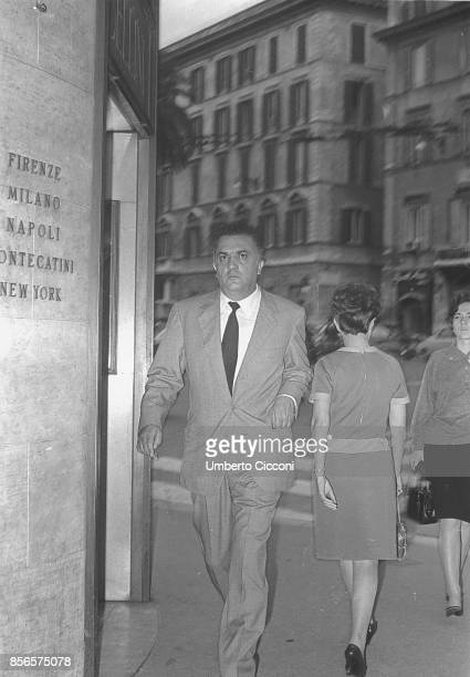 Italian film director Federico Fellini walking in 'Piazza di Spagna' in Rome 1966