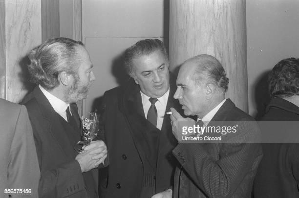 Italian film director Federico Fellini with Costume and Set Designer Piero Gherardi and film director Luigi Comencini at the premiere of the movie...