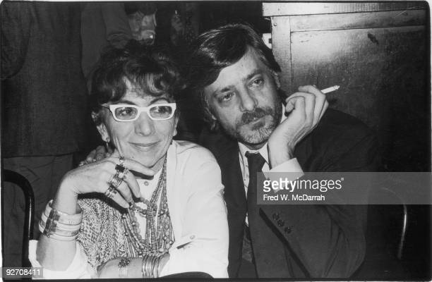 Italian film director Lina Wertmuller and her frequent lead actor Giancarlo Giannini pose together at a table January 29 1978