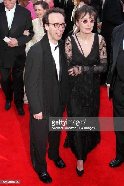 Italian film director Roberto Benigni with his wife Nicoletta Braschi at the 72nd Annual Academy Awards held at the Shrine Auditorium in Los Angeles
