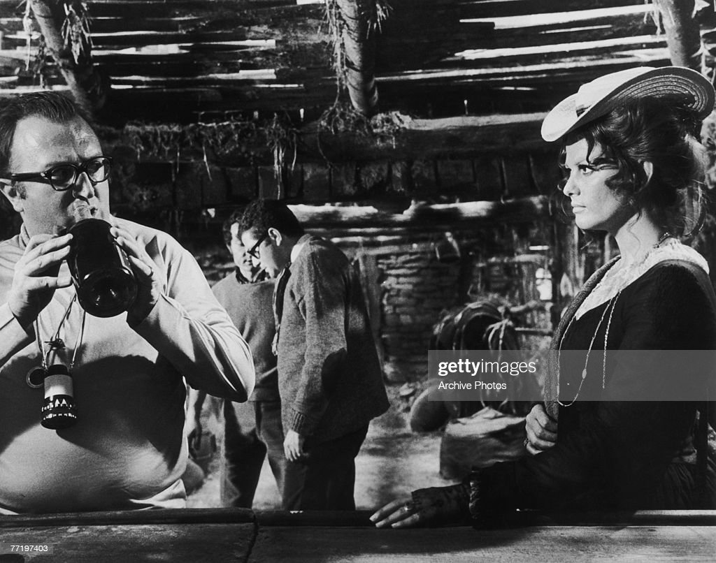 Italian film director Sergio Leone (1929 - 1989) with actress Claudia Cardinale on the set of the western 'Once Upon a Time in the West' ('C'era una volta il West'), 1968.