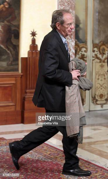 Italian Finance Minister Pier Carlo Padoan arrives at Palazzo Chigi for a meeting with prime minister Matteo Renzi on February 28 2014 in Rome Italy...