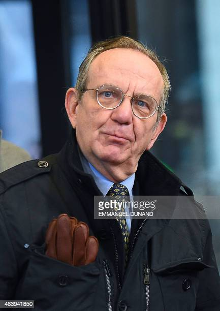Italian Finance Minister Pier Carlo Padoan arrives for an emergency Eurogroup finance ministers meeting at the European Council in Brussels on...