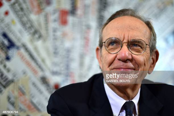 Italian Finance Minister Pier Carlo Padoan smiles during a press conference at the Foreign Press Club in Rome on August 4 2015 AFP PHOTO / GABRIEL...