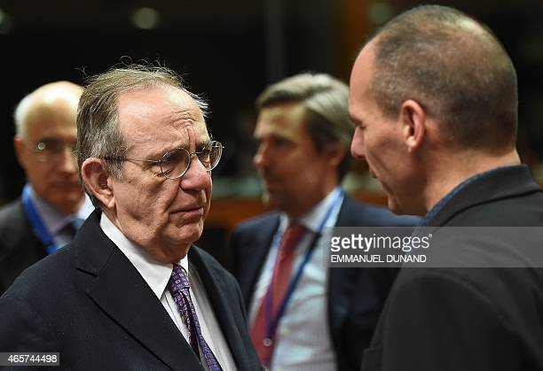 Italian Finance Minister Pier Carlo Padoan speaks with Greece's Finance Minister Yanis Varoufakis during an economic and financial affairs council at...