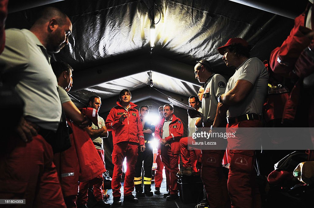 Italian Fire Brigade Divers meet for an operational briefing to search for Costa Concordia victim on September 25, 2013 in Giglio Porto, Italy. Yesterday the search resumed for the missing bodies of Maria Grazia Trecarichi and Russel Rebello, whose bodies were never found after the Costa Concordia capsized on January 13, 2012, leaving 32 people dead. Specialist divers from the coastguard, fire brigade, navy and police have begun searching the area between the righted ship and the coast and other parts of the vessel which were previously off limits.