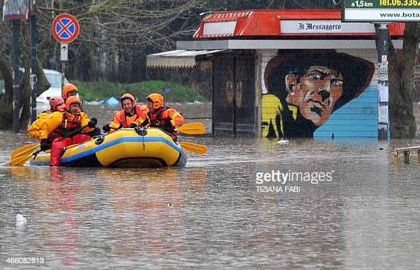 Italian firefighters patrol with a boat in a flooded area in Prima Porta in the outskirts of Rome on January 31 2014 after torrential rains hit the...