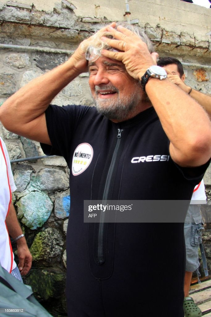 Italian Five Star Movement political leader Beppe Grillo gets ready before swimming across the Strait of Messina in an election campaign stunt and in protest against plans for a bridge from the Italian mainland to Sicily on October 10, 2012 in Cannitello, in the Italian region of Calabria. The populist leader, which campaigns on a variety of environmental and anti-corruption issues, is taking part in local elections in Sicily scheduled for October 28 to elect a new regional governor and assembly.