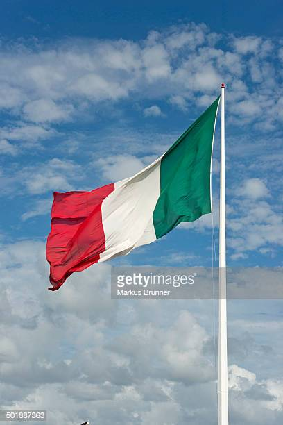 Italian flag against cloudy sky