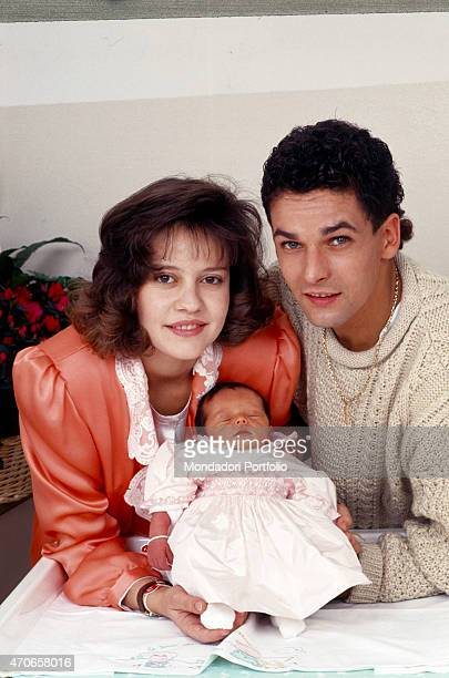 'Italian football champion Roberto Baggio is taken together with his family Baggio's wife Andreina Fabbi is showing the newly born Valentina to the...