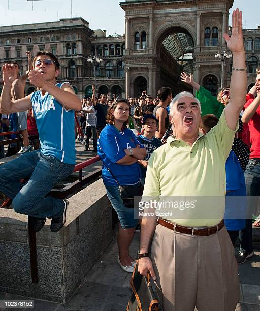 Italian football fans react while watching the 2010 FIFA World Cup South Africa Group F match between Slovakia and Italy on a screen in Piazza del...