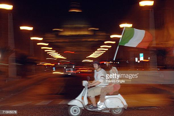 Italian football fans ride their Vespa around St Peter's Basilica celebrating the 30 victory of Italy over Ukraine of the World Cup 2006 quarter...