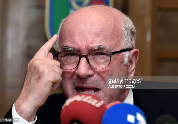 Italian Football Federation President Carlo Tavecchio gestures during a press conference held after his official resignation during a crisis meeting...