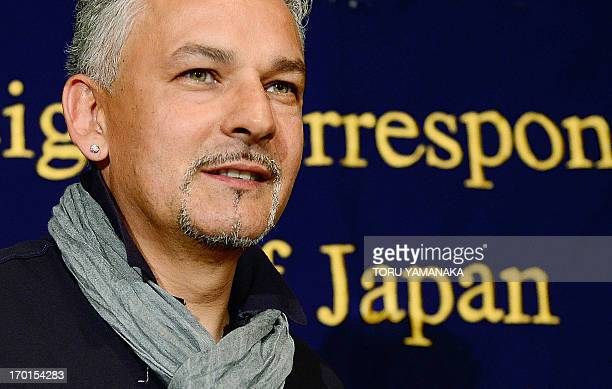 Italian football legend Roberto Baggio attends a press conference at the Foreign Correspondents' Club of Japan in Tokyo on June 8 2013 Baggio is here...