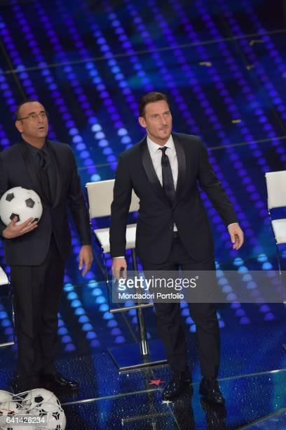 Italian football player Francesco Totti and television host Carlo Conti at 67th Sanremo Music Festival Sanremo february 8 2017