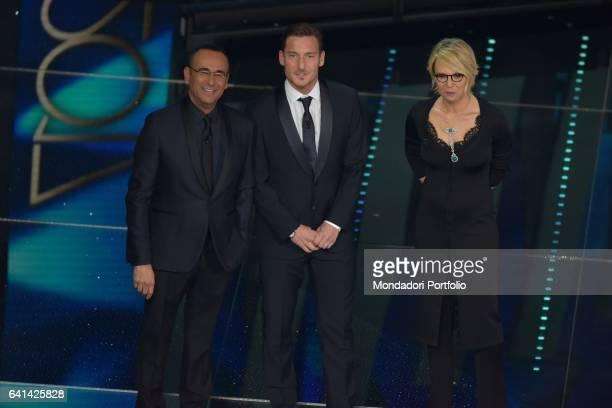 Italian football player Francesco Totti with television host Maria De Filippi and Carlo Conti at 67th Sanremo Music Festival Sanremo february 8 2017